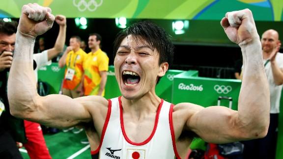 Japanese gymnast Kohei Uchimura celebrates after winning the individual all-around. Uchimura also won the all-around in 2012.