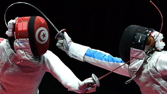 Tunisian fencer Ines Boubakri, left, competes against Italy's Elisa Di Francisca during a semifinal bout in the individual foil competition. Di Francisca advanced to the final but lost to Russia's Inna Deriglazova.