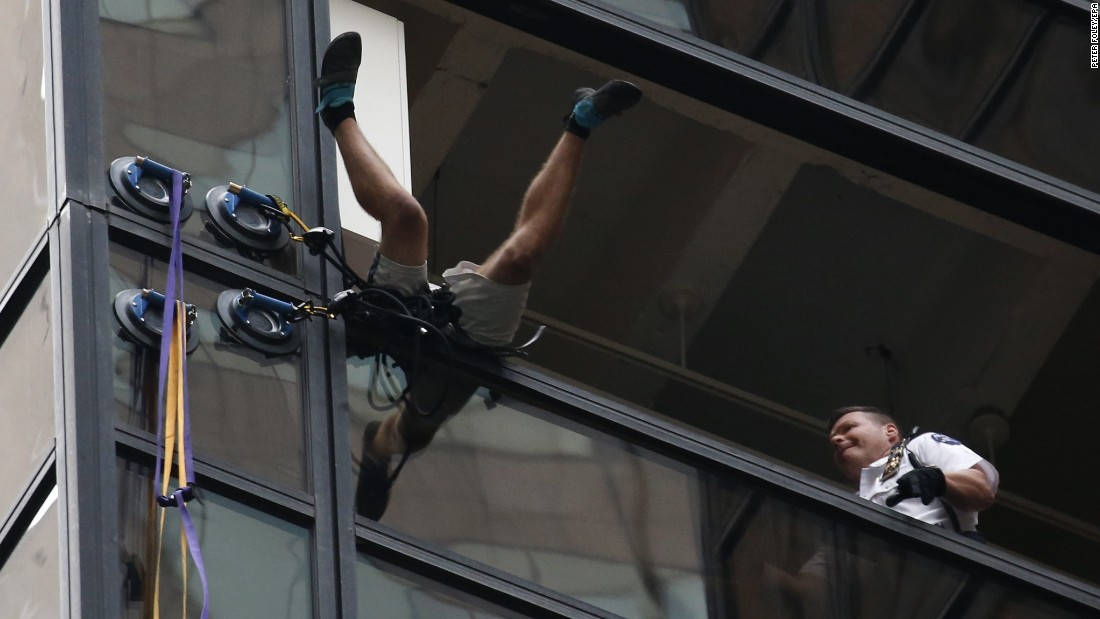 "New York City police grab a man <a href=""http://www.cnn.com/2016/08/10/politics/trump-tower-suction-cups/"" target=""_blank"">who was climbing the Trump Tower using giant suction cups</a> on Wednesday, August 10. The 19-year-old was arrested and taken to Bellevue Hospital for a psychological evaluation, according to a law enforcement official. He was later charged with reckless endangerment and criminal trespassing."