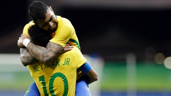 Gabriel Barbosa, top, hugs his Brazilian teammate Neymar after scoring the first goal in a 4-0 victory over Denmark. It was the first goal Brazil had scored in three matches.