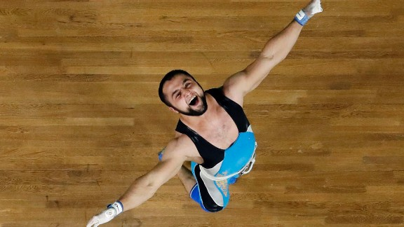Nijat Rahimov, a weightlifter from Kazakhstan, celebrates after setting a world-record clean and jerk during the 77-kilogram (170-pound) competition. Rahimov lifted 214 kilograms (471.8 pounds) on the way to winning gold.