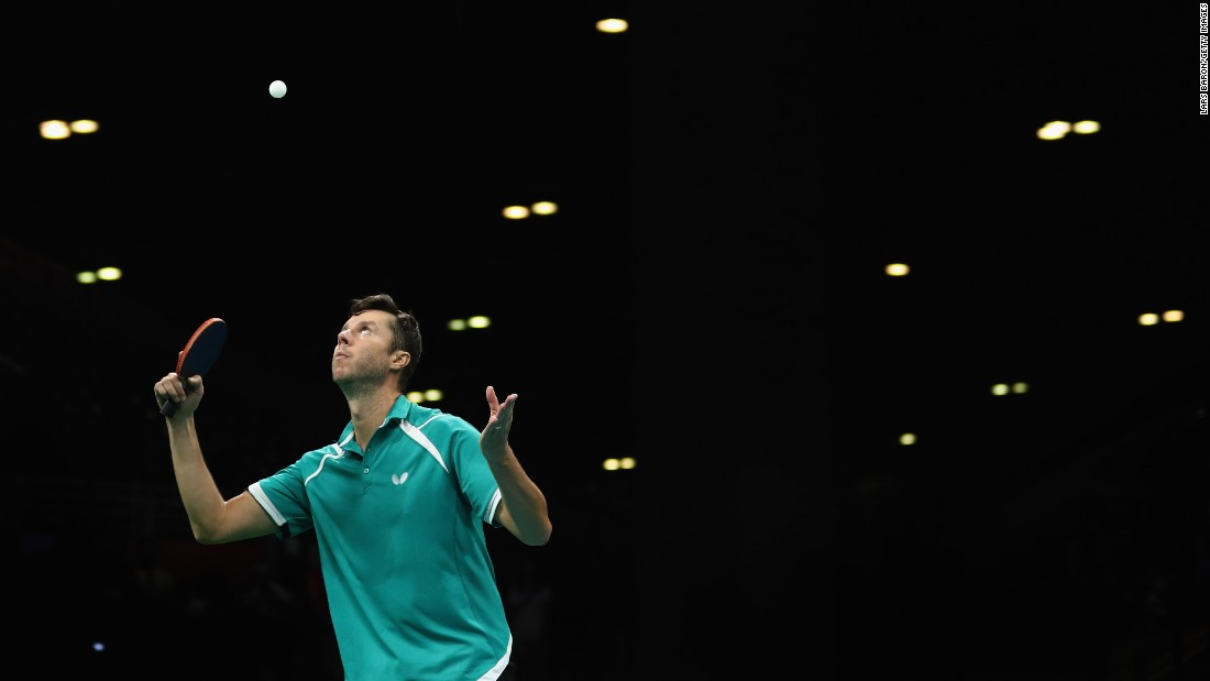 Vladimir Samsonov, a table tennis player from Belarus, plays a shot against Zhang Jik of China.