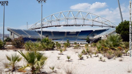 "ATHENS, GREECE - JULY 31: General view of the Beach Volleyball Olympic Stadium at Faliro Olympic Complex in Athens, Greece on July 31, 2014. Ten years ago the XXVIII Olympiad was held in Athens from the 13th - 29th August with the motto ""Welcome Home"". The cost of hosting the games was estimated to be approx 9 billion euros with the majority of sporting venues built specifically for the games. Due to Greece's economic frailties post Olympic Games there has been no further investment and the majority of the newly constructed stadiums now lie abandoned. (Photo by Milos Bicanski/Getty Images)"