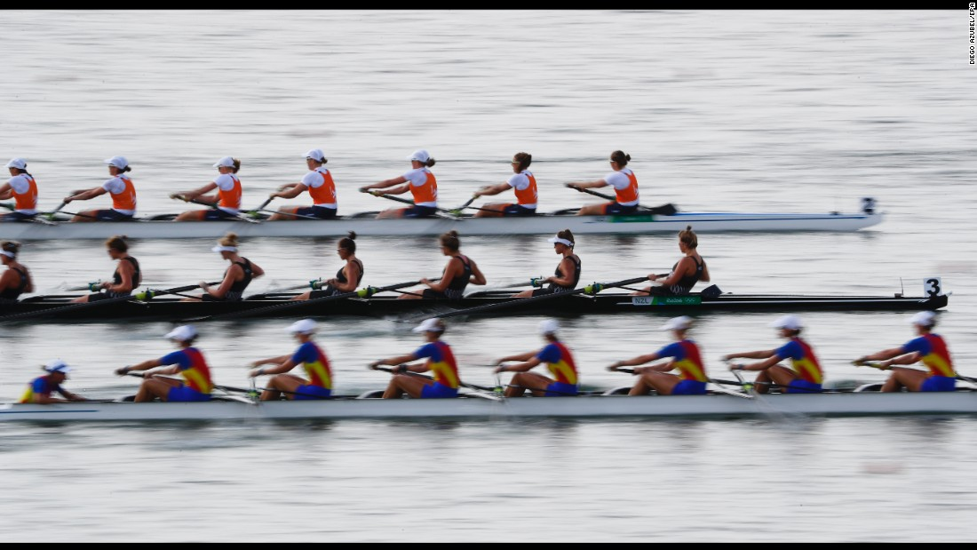 Rowing teams from Romania, New Zealand and the Netherlands race during the women's eight competition.