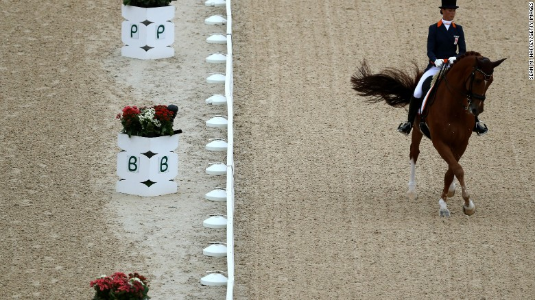 RIO DE JANEIRO, BRAZIL - AUGUST 10:  Adelinde Cornelissen of Netherlands riding Parzival competes druing the Dressage Individual Grand Prix event on Day 5 of the Rio 2016 Olympic Games at the Olympic Equestrian Centre on August 10, 2016 in Rio de Janeiro, Brazil.  (Photo by Sean M. Haffey/Getty Images)