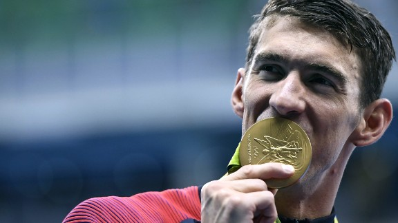 U.S. swimmer Michael Phelps -- the most decorated Olympian of all time -- celebrates with his gold medal after the 4x200 freestyle on Tuesday, August 9. Phelps has won 21 gold medals so far in his career (25 medals in all), and he