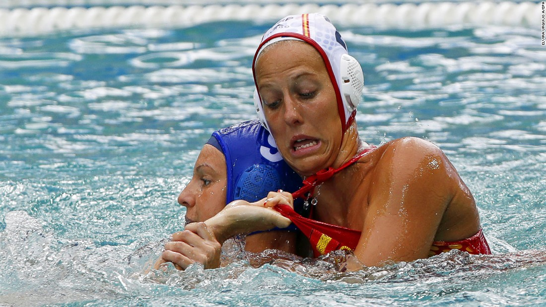 Hungary's Ildiko Toth, left, tussles with Spain's Marta Bach Pascual during a water polo game.