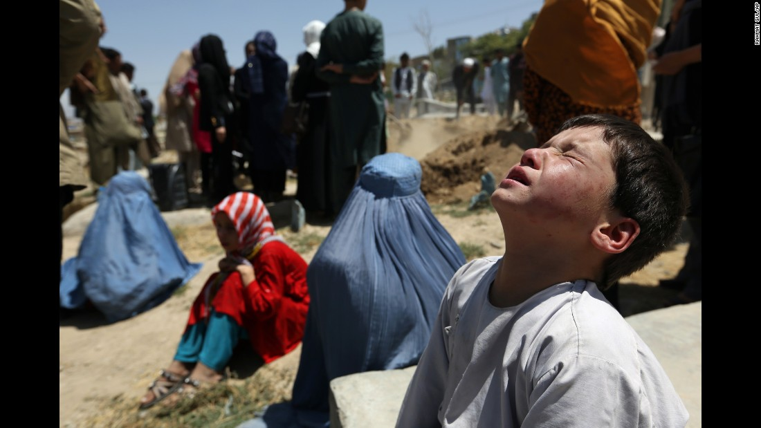 The young brother of Zarah, a pregnant 14-year-old who died after she was set on fire in her husband's home, attends her funeral in Kabul, Afghanistan, on Wednesday, August 10. Zarah was allegedly tortured and killed by her husband's family as revenge for a marriage deal that fell through.