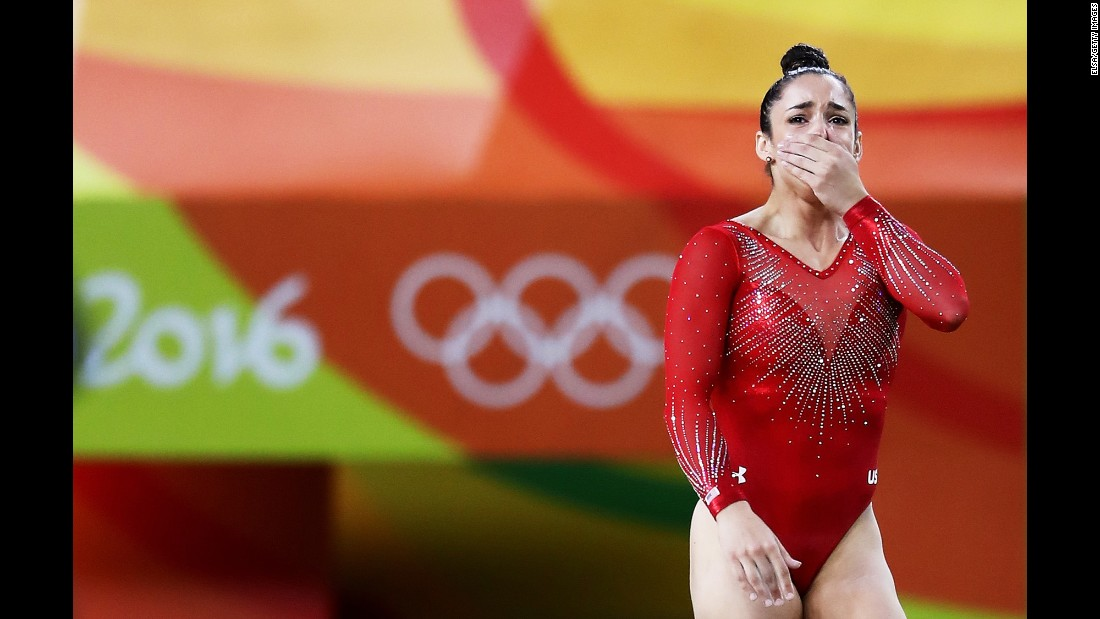 Raisman reacts after her balance beam performance.