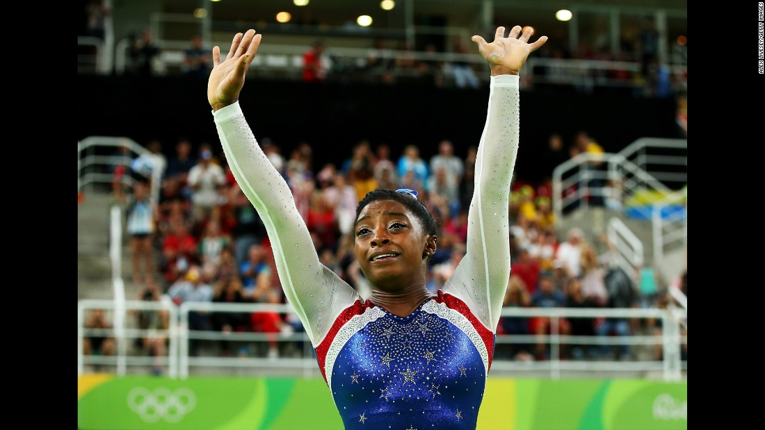 "U.S. gymnast Simone Biles waves to fans after <a href=""http://www.cnn.com/2016/08/11/sport/simone-biles-usa-gymnastics-rio/index.html"" target=""_blank"">winning gold in the individual all-around.</a> Biles also won team gold earlier this week."