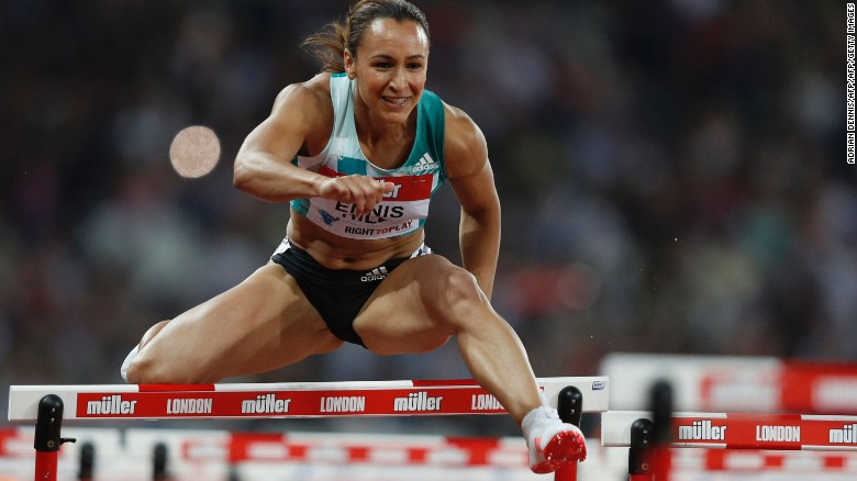 Britain's Jessica Ennis-Hill clears a hurdle in a final of the women's 100m hurdles at the IAAF Diamond League Anniversary Games athletics meeting at the Queen Elizabeth Olympic Park stadium in Stratford, east London on July 22, 2016. / AFP / Adrian DENNIS        (Photo credit should read ADRIAN DENNIS/AFP/Getty Images)