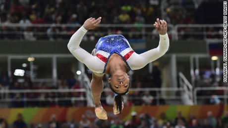 US gymnast Simone Biles competes in the beam event of the women's individual all-around final of the Artistic Gymnastics at the Olympic Arena during the Rio 2016 Olympic Games in Rio de Janeiro on August 11, 2016. / AFP / Emmanuel DUNAND        (Photo credit should read EMMANUEL DUNAND/AFP/Getty Images)