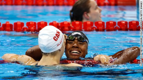 Simone Manuel and Penny Oleksiak of Canada embraced after their dead heat.