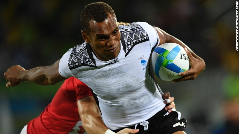 Fiji's Osea Kolinisau scores a try in the men's rugby sevens gold medal match between Fiji and Britain during the Rio 2016 Olympic Games.