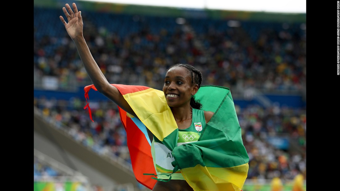 "Ethiopia's Almaz Ayana celebrates after winning the 10,000 meters. She stunned spectators by crossing the line in 29 minutes, 17.45 seconds, <a href=""http://www.cnn.com/2016/08/12/sport/rio-olympics-ethiopia-10000m-world-record/index.html"" target=""_blank"">smashing a record</a> that had stood for nearly 23 years."