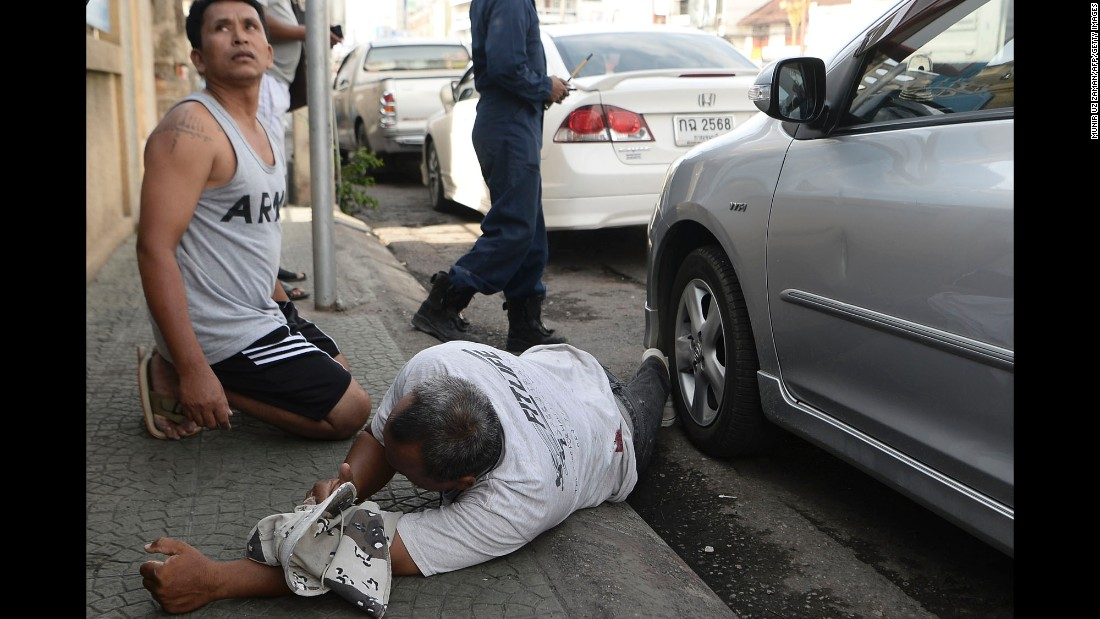 An injured man is seen on the ground after a small bomb exploded in Hua Hin on August 12.