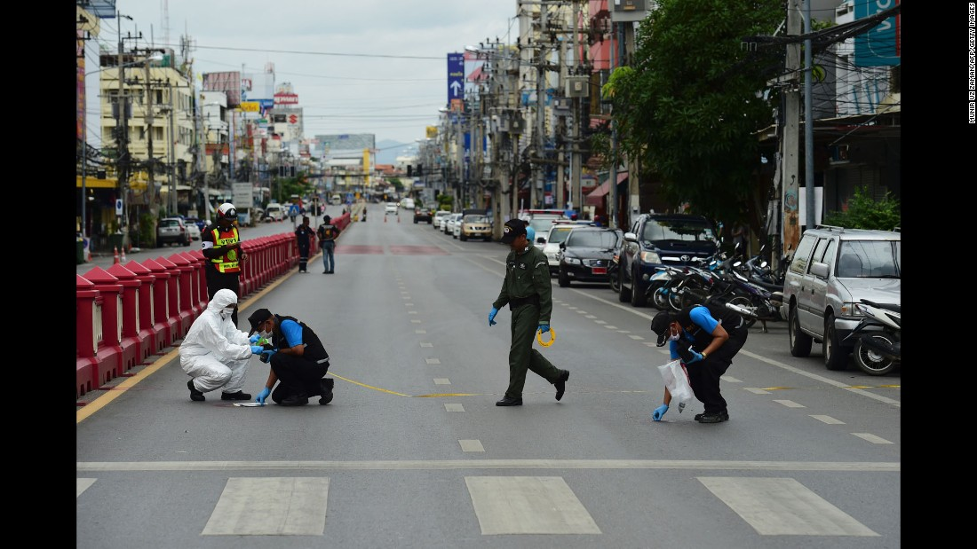Forensic police gather evidence at the scene of a small blast in Hua Hin on August 12.
