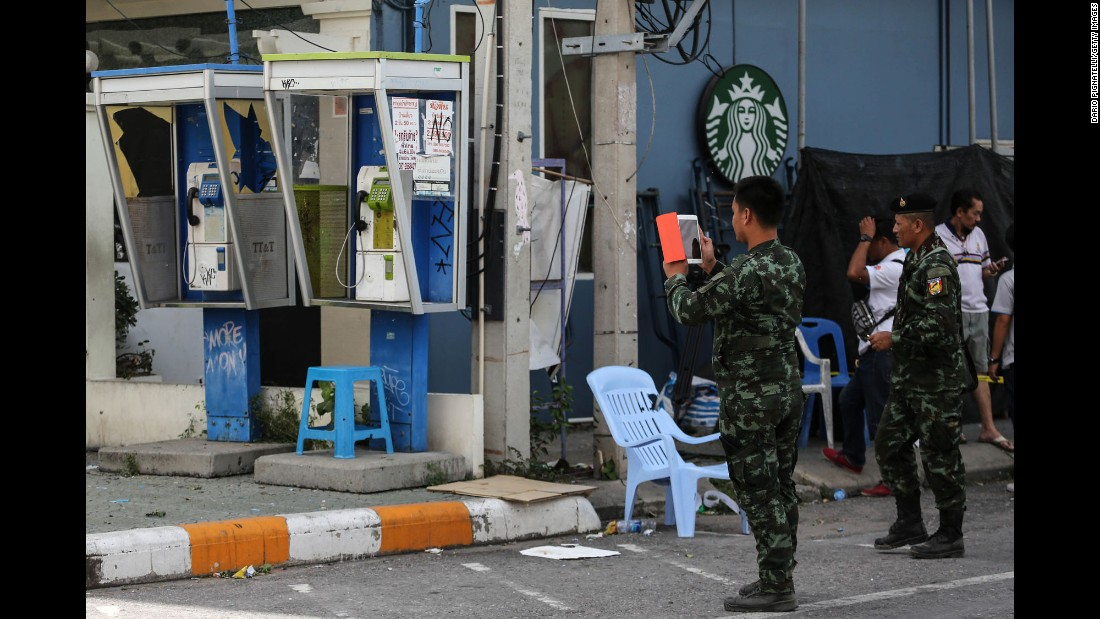 Thai officials document the site of an explosion near a Starbucks coffee shop in Hua Hin on Friday, August 12. The series of attacks comes just days after the country voted on a controversial constitutional amendment, which gives the ruling military more power.