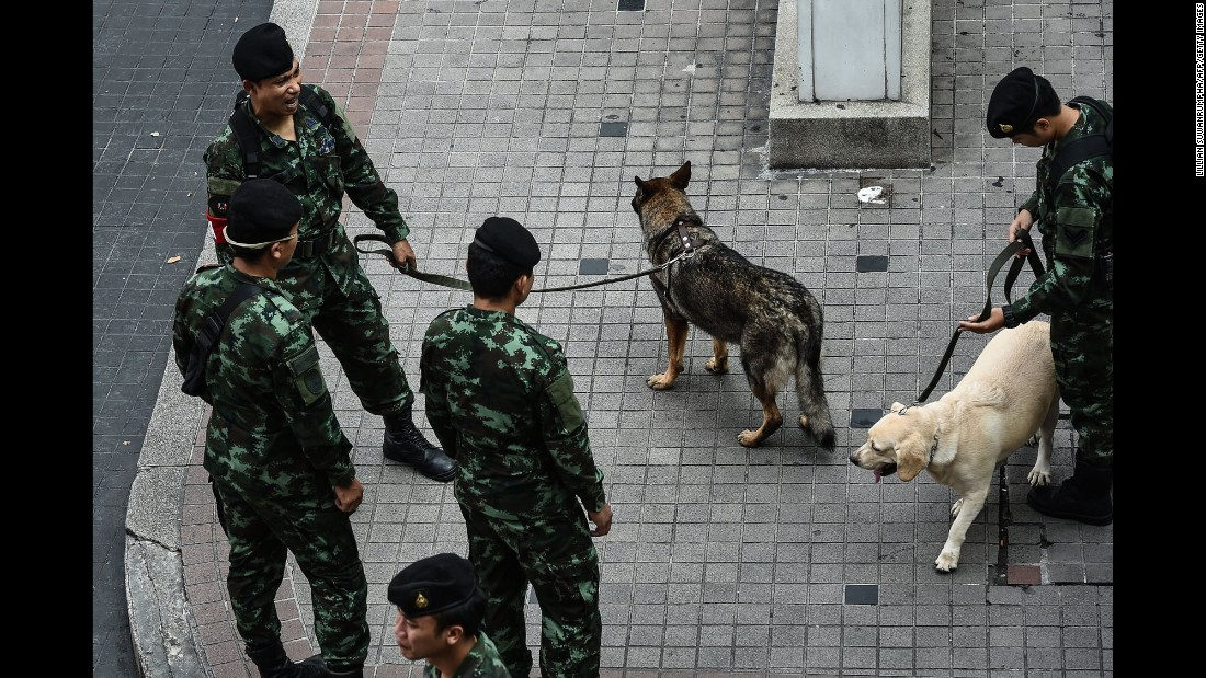 Thai soldiers and bomb-sniffing dogs gather near the Erawan Shrine on August 12 in Bangkok. The shrine, a popular tourist spot, was the site of a bomb attack almost one year ago. Small bomb attacks are common in Thailand during times of heightened political tension, but there have been few such incidents in the past year after the 2015 blast at Erawan Shrine, and it is rare for tourists -- a key source of income for the kingdom -- to be targeted.