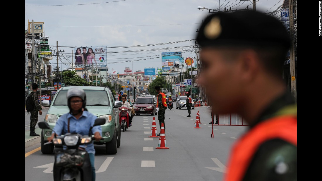 Thai Army officers direct traffic on Friday, August 12 near the site of coordinated blasts in Hua Hin.
