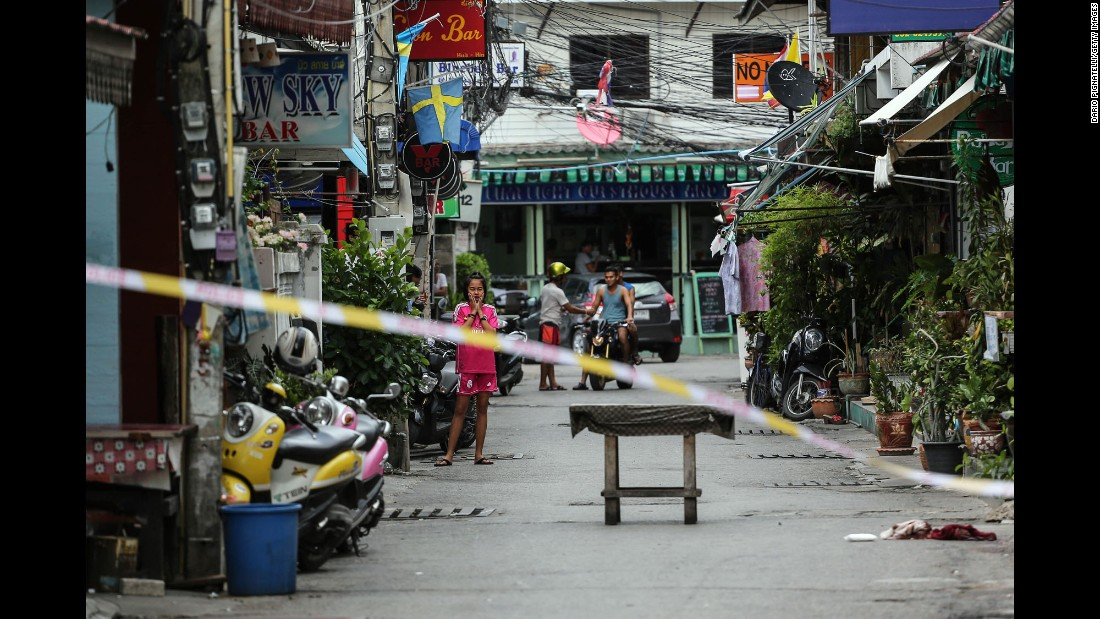 A girl looks at the scene of an explosion on Friday, August 12 in Hua Hin, Thailand.