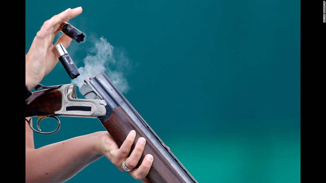 Christine Wenzel of Germany ejects cartridges during skeet qualification.