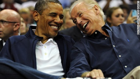 Then-President Barack Obama and Vice President Joe Biden share a laugh during a pre-Olympic exhibition basketball game on July 16, 2012 in Washington, DC.