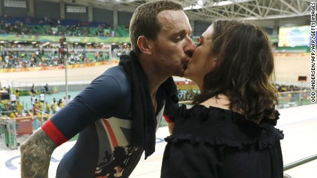 Britain's Bradley Wiggins (L) kisses his wife Catherine Wiggins after winning gold in the men's Team Pursuit finals track cycling event at the Velodrome during the Rio 2016 Olympic Games in Rio de Janeiro on August 12, 2016. / AFP / Odd ANDERSEN        (Photo credit should read ODD ANDERSEN/AFP/Getty Images)