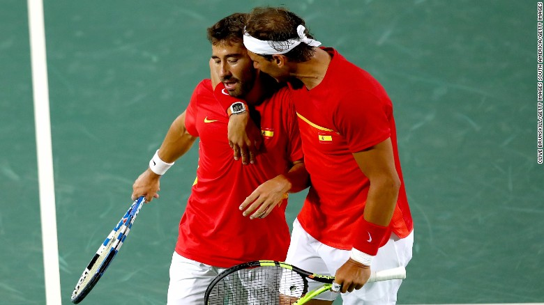Marc Lopez and Rafael Nadal of Spain confer during the Men's Doubles Gold medal match against Horia Tecau and Florin Mergea of Romania on Day 7 of the Rio 2016 Olympic Games at the Olympic Tennis Centre on August 12, 2016 in Rio de Janeiro, Brazil.