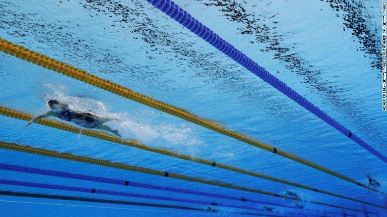 RIO DE JANEIRO, BRAZIL - AUGUST 12:  Katie Ledecky of the United States leads the field in the Women's 800m Freestyle Final on Day 7 of the Rio 2016 Olympic Games at the Olympic Aquatics Stadium on August 12, 2016 in Rio de Janeiro, Brazil.  (Photo by Adam Pretty/Getty Images)