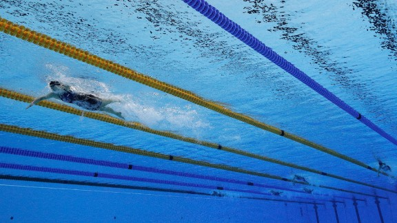 RIO DE JANEIRO, BRAZIL - AUGUST 12:  Katie Ledecky of the United States leads the field in the Women