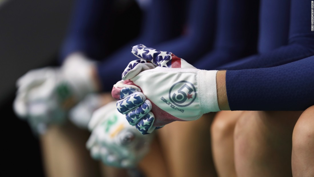 Patriotic gloves are worn by Team USA as they prepare to compete in the women's track cycling team pursuit.