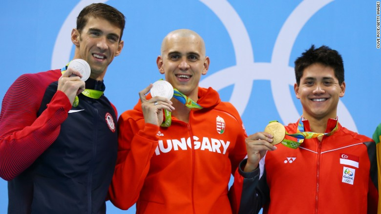 Do olympians win money with their medals to honor