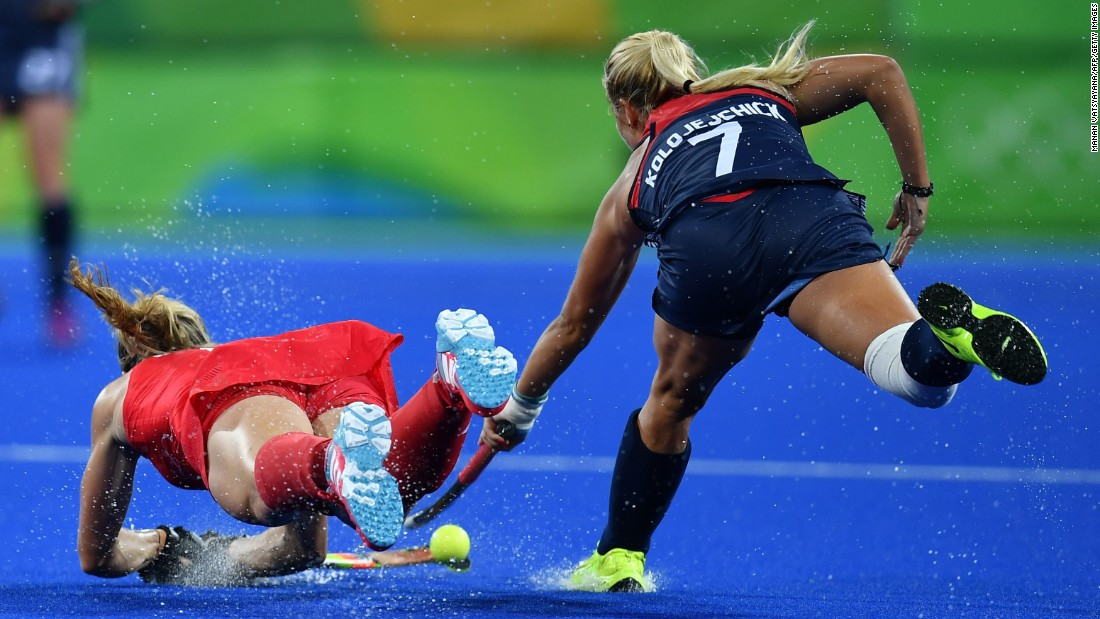 US field hockey player Kelsey Kolojejchick, right, vies for the ball with Great Britain's Crista Cullen.
