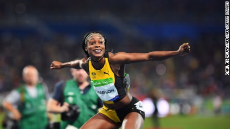 Elaine Thompson celebrates after taking gold in the women's 100 meters.
