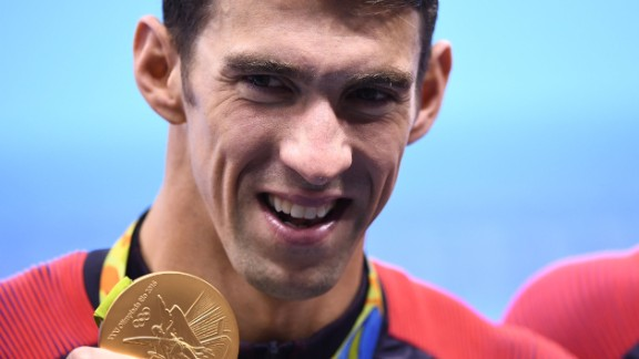 USA's Michael Phelps poses with his gold medal during the podium ceremony of the Men's swimming 4 x 100m Medley Relay Final at the Rio 2016 Olympic Games at the Olympic Aquatics Stadium in Rio de Janeiro on August 13, 2016.