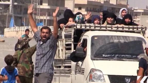 Residents celebrate the Kurdish liberation of Manbij from ISIS.
