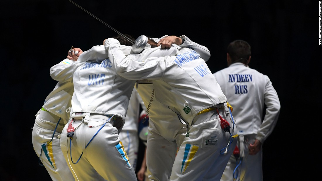 Ukraine's fencing team celebrates after winning the men's team epee quarter-final bout against Russia.