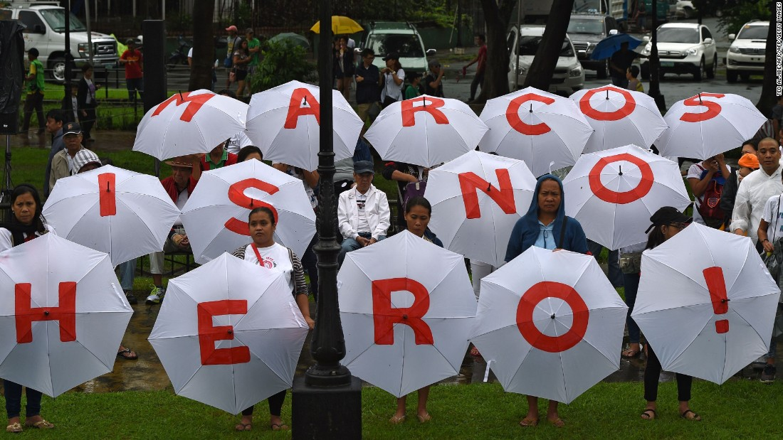 "Former congressman Walden Bello compared interring Marcos in the cemetery as akin to ""burying Al Capone in Arlington National Cemetery"" — although he added: ""Marcos was worse."""