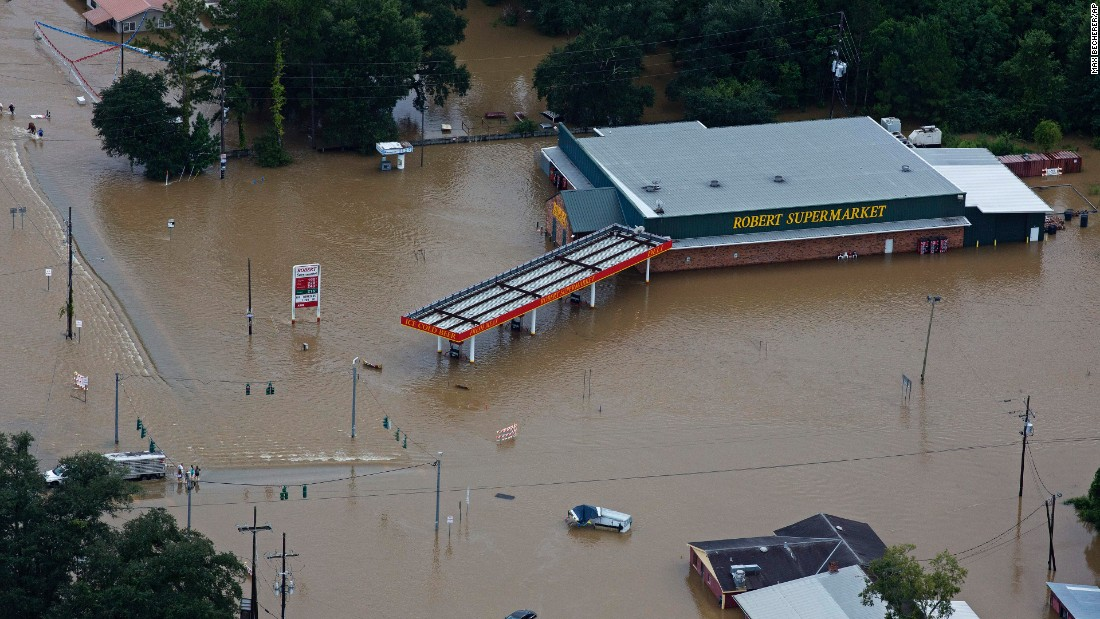 Floodwaters overwhelm businesses in Hammond on August 13.