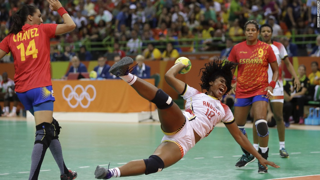 Angola's Albertina Cruz Kassoma, center, is fouled by Spain's Elizabet Chavez during a women's preliminary handball match.