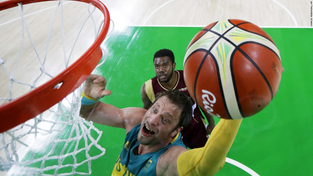 Australia's David Andersen drives to the basket past Venezuela's Nestor Colmenares.