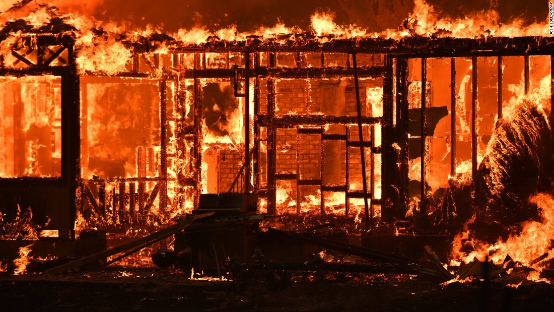 A home burns near the town of Lower Lake, California.