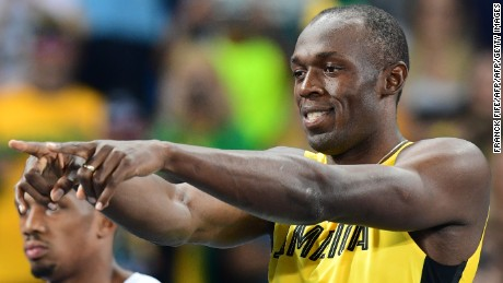 Jamaica's Usain Bolt gestures in the Men's 100m Semifinal during the athletics event at the Rio 2016 Olympic Games at the Olympic Stadium in Rio de Janeiro on August 14, 2016.   / AFP / FRANCK FIFE        (Photo credit should read FRANCK FIFE/AFP/Getty Images)