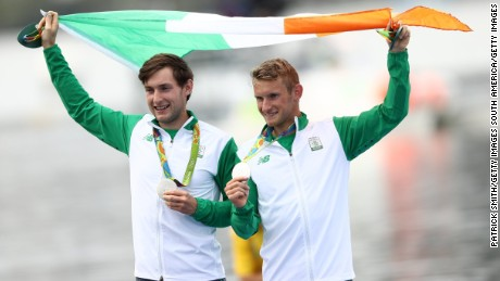 Silver medalists Paul (left) and Gary O'Donovan of Ireland celebrate after getting their medals Friday in Rio.