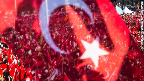 "People wave Turkish flags during a rally organised by the main opposition group, the secular and centre-left Republican People's Party (CHO), on July 24, 2016 in Istanbul's Taksim square. Many thousands of flag-waving Turks massed on July 24, 2016 for the first cross-party rally to condemn the coup attempt against President Recep Tayyip Erdogan, amid an ongoing purge of suspected state enemies. Istanbul's Taksim square was transformed into a sea of red national flags in what was dubbed a ""democracy festival"". But in stark contrast to the celebratory and patriotic mood in Istanbul, human rights group Amnesty International in London claimed it had ""credible evidence"" of the beating and torture of detainees. / AFP / GURCAN OZTURK        (Photo credit should read GURCAN OZTURK/AFP/Getty Images)"