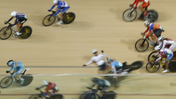 Canada's Allison Beveridge and Germany's Anna Knauer fall during the scratch race portion of the omnium track cycling event.