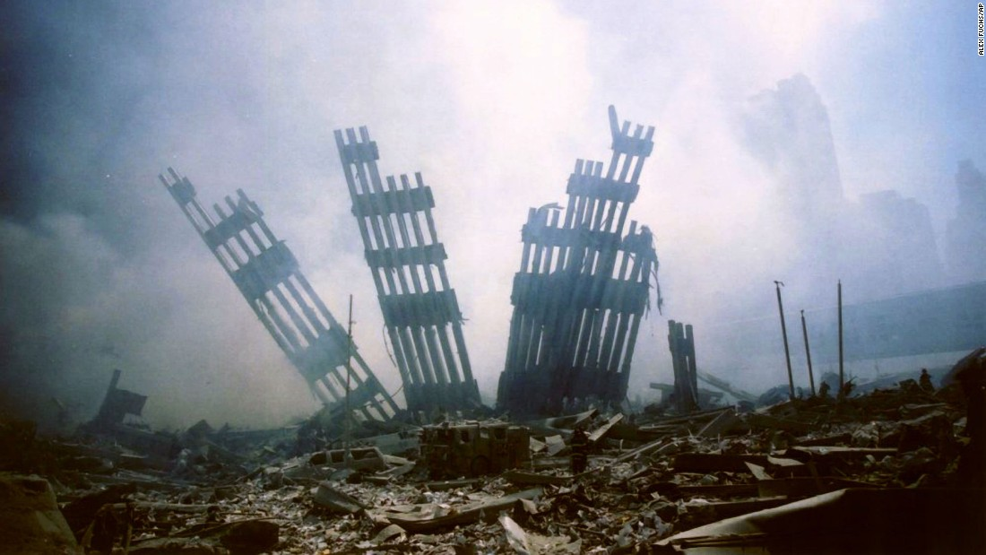 Remains of the World Trade Center are seen amid the debris.