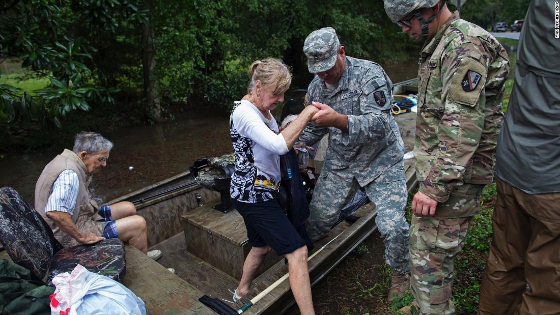 Louisiana flooding: 'Cajun Navy' answers call for ...