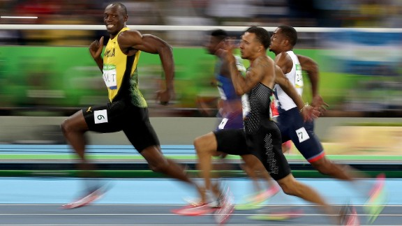 Jamaican sprinter Usain Bolt looks back at his competitors during a 100-meter semifinal on Sunday, August 14. Bolt won the final a short time later, becoming the first man in history to win the 100 meters at three straight Olympic Games.
